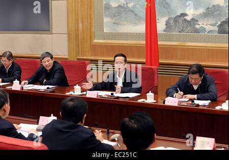 Beijing, China. 8th Dec, 2014. Chinese Vice Premier Zhang Gaoli (2nd R, rear) presides over a meeting of the National - Stock Photo