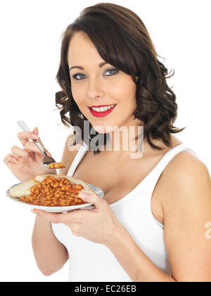 Healthy Young Woman Eating Baked Beans on Toast - Stock Photo