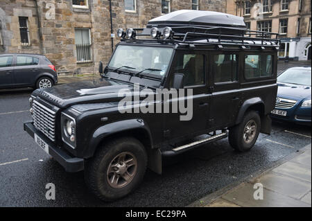 land rover defender 110 with roof box parked on street in. Black Bedroom Furniture Sets. Home Design Ideas