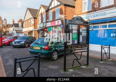 Local shops and community notice board, West Bridgford, Nottinghamshire, England, UK - Stock Photo