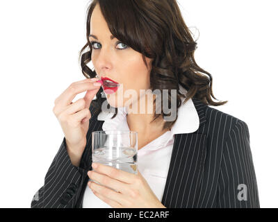 Unwell Business Woman Taking Tablets - Stock Photo