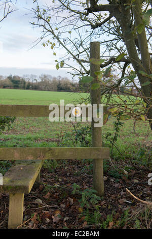 Foot path sign and stile field corner - Stock Photo