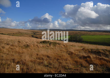 Autumn view over Dartmoor National Park near Mary Tavy, with a distant farm in a valley, Devon, England. - Stock Photo