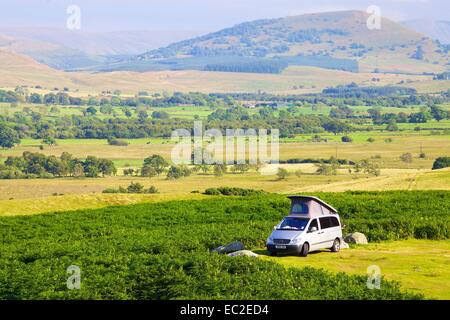 Camper Van parked on moor The Lake District National Park, Cumbria, England, UK. - Stock Photo