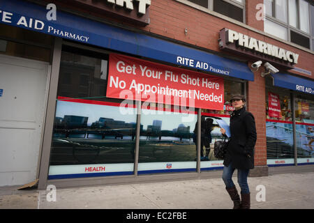 A sign outside a Rite Aid drugstore in New York on Friday, December 5, 2014 advertises that flu shots are available. - Stock Photo