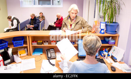 An NHS waiting room and reception desk - Stock Photo