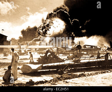 Captured Japanese photograph taken during the attack on Pearl Harbor, December 7, 1941.  In the distance, the smoke - Stock Photo