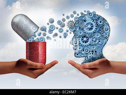 Brain medicine mental health care concept as hands holding an open pill capsule releasing gears to a human head - Stock Photo
