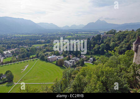 Houses in Alps landscape on green grass lawn. - Stock Photo
