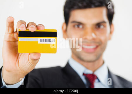 Indian business man showing credit card stock photo royalty free indian business man showing credit card stock photo reheart Choice Image