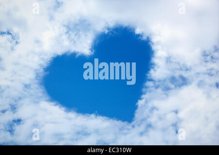 Heart from cloud in the blue sky - Stock Photo