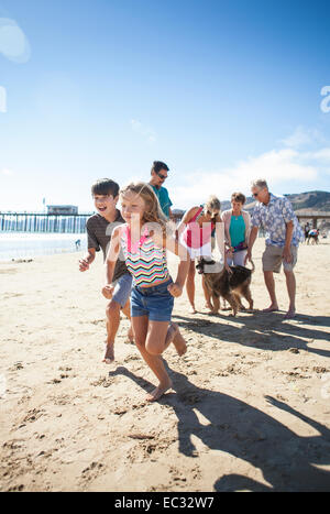 Family takes a stroll on the beach, Pismo Beach, Central Coast, California, United States of America - Stock Photo
