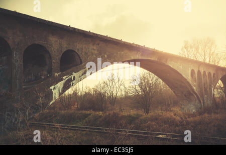 Retro vintage filtered picture of an arch bridge. - Stock Photo