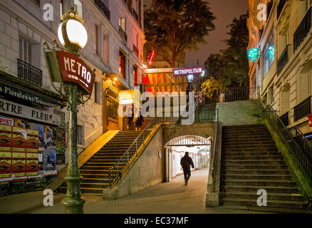 entrance metro montmartre paris france night - Stock Photo