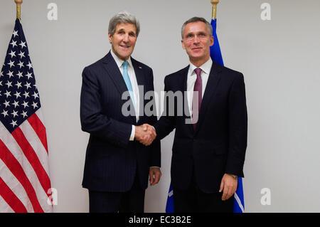 U.S. Secretary of State John Kerry shakes hands with newly elected NATO Secretary General Jens Stoltenberg before - Stock Photo