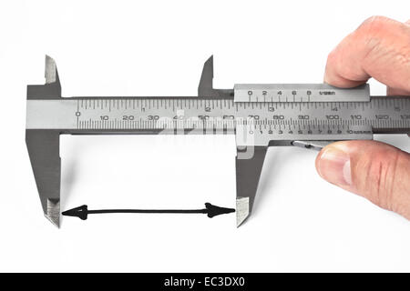 Man measuring distance with caliper - Stock Photo