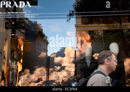 Reflection in a window of a Prada fashion store on the Upper East Side. This area of Manhattan is also known as - Stock Photo