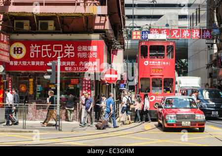 Busy Hong Kong Island street scene in Sheung Wan, Hong Kong, China - Stock Photo
