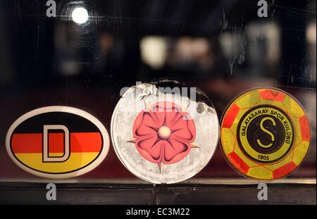 Bonn, Germany. 09th Dec, 2014. A 'D sign' for Germany and a sticker of a Turkish soccer club (R) are seen on a window - Stock Photo