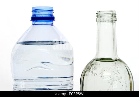 Glass and pvc water bottles - Stock Photo