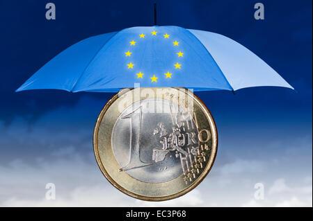 EU sign, one euro coin and umbrella - Stock Photo