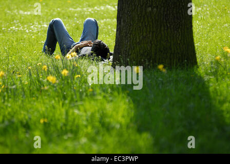 Spring in Hamburg, Young Man lying in Grass, Germany - Stock Photo