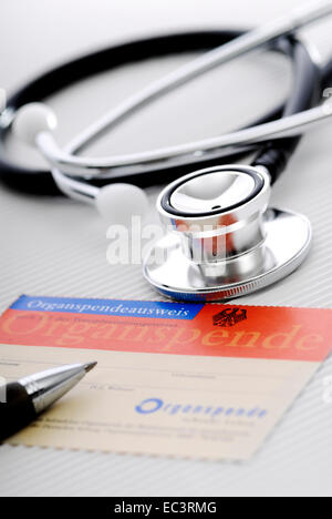 Stethoscope and organ donor card - Stock Photo