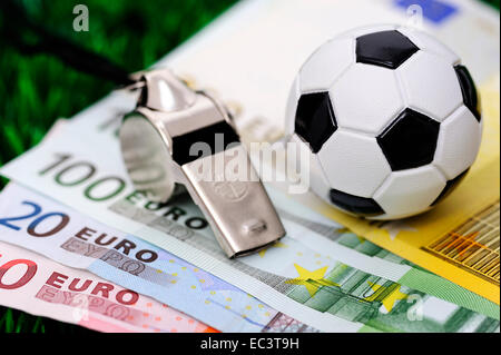 Soccer ball on euro banknotes - Stock Photo