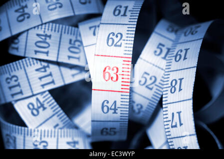 Number 63 on measuring tape, retirement pension at age 63 - Stock Photo