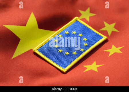 EU flag on flag of China, economic relations - Stock Photo