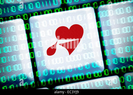 Bleeding heart on computer key, heartbleed bug - Stock Photo