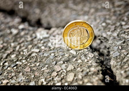 Greek euro coin on cracked ground, debt crisis - Stock Photo