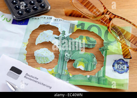 Torn one hundred euro bill, pension at age 63 - Stock Photo