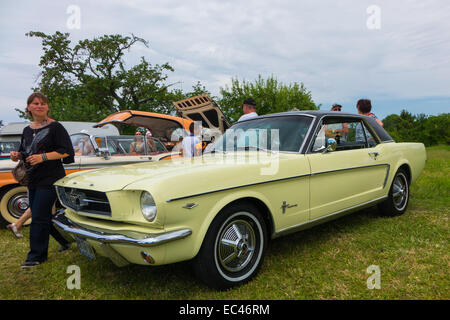 Ford Mustang, yellow at the Locomotion Day in Francueil, France - Stock Photo