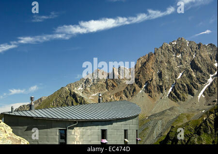 View across the roof of the Velan mountain refuge to the peaks of the Pennine Alps, Switzerland - Stock Photo