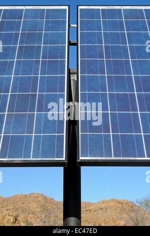 Solar panels in use in a semi-desert environment, South Africa - Stock Photo