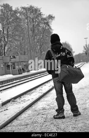 The guy waits of a train - Stock Photo