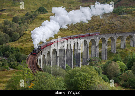 The Jacobite steam train on the Glenfinnan Viaduct, West Highland Line in Scotland. - Stock Photo