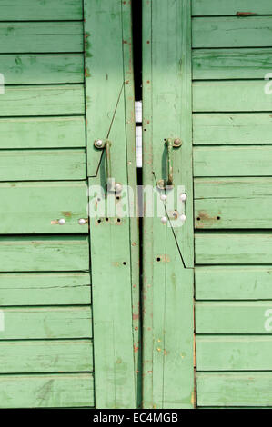 Green door of a warehouse in the Port of Hamburg, Germany - Stock Photo