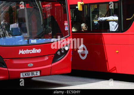 Two double decker red London buses raveling in Oxford Street, London - Stock Photo