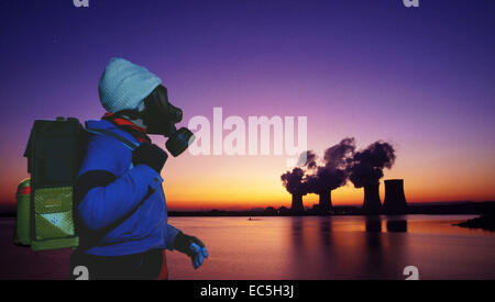 Child with gas mask in the evening in front of the nuclear power station Cattenom, France - Stock Photo