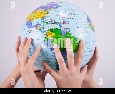 Hands are holding up a globe - Stock Photo