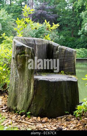 Wooden chair in the castle garden Schloss Berleburg Castle Bad Berleburg district Siegen Wittgenstein North Rhine - Stock Photo