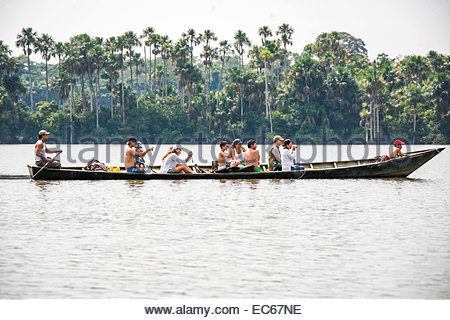 Tourists travelling in boat - Peru - Stock Photo
