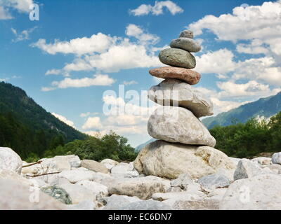 Stone figure on the River Isar in the Bavarian Alps near Lenggries and Wallgau at the Vorderriss - Stock Photo