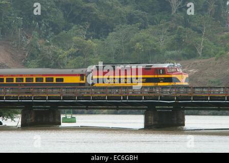 Panama Canal train crossing a bridge near Gamboa - Stock Photo