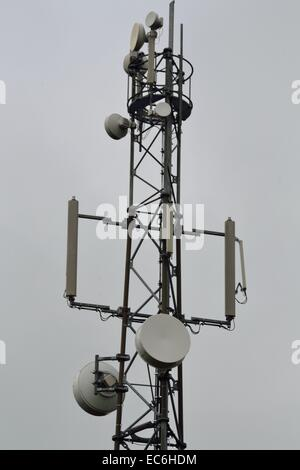 Cellular connection via mobile phone mast - Stock Photo