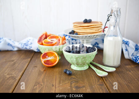 Pancakes and fresh fruits for breakfast - Stock Photo