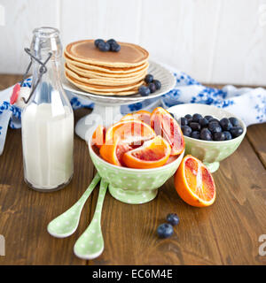 Breakfast with pancakes and fresh fruits - Stock Photo