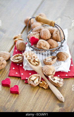Various walnuts in little vintage basket - Stock Photo